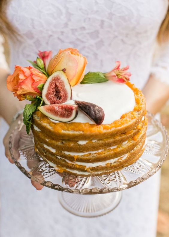 warm-colored fig and flower wedding cake