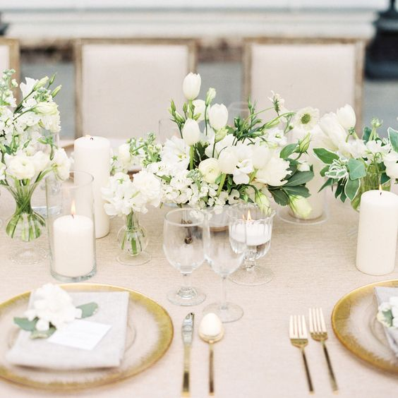 picture of grey white and gold table setting with white