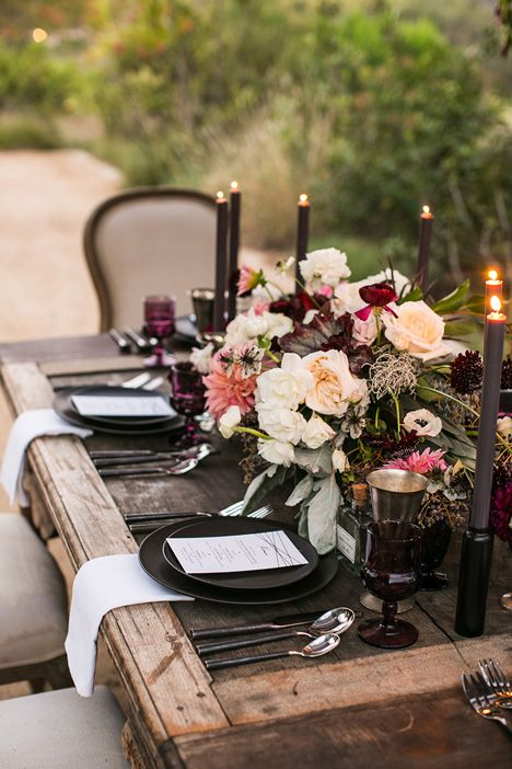 rustic table with a dramatic color palette and dark candles