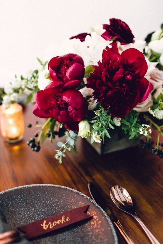 wedding table setting with burgundy details