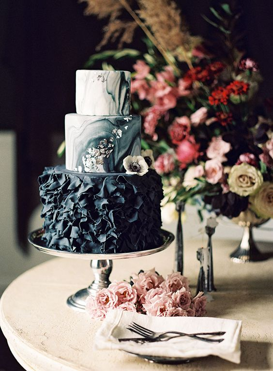 three tier marble wedding cake with cascading flowers
