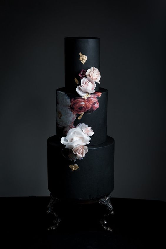 black wedding cake with painted and natural flowers (photo by Cavin Elizabeth Photography)