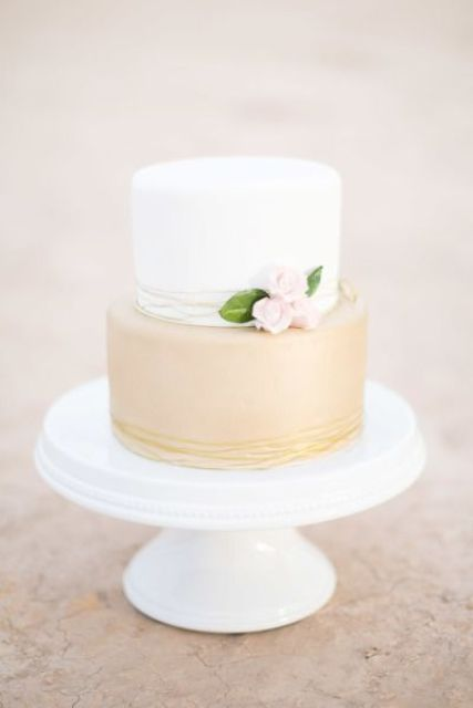 metallic and neutral wedding cake decorated with flowers