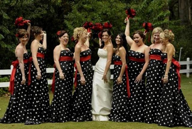 Chic black and white polka dot bridesmaid dresses with red accent