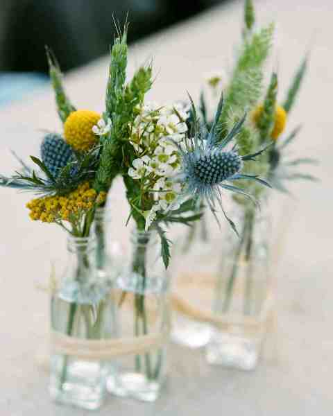 Flower in bottles wrapped by twine