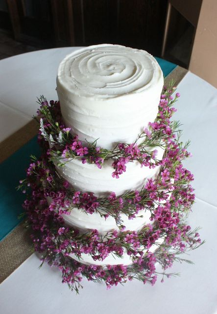 Four tiered wedding cake decorated with flowers