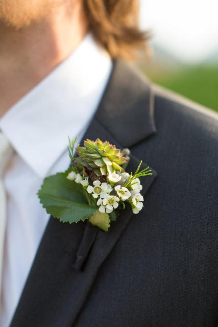 Green and white color boutonniere