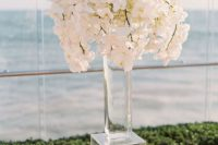Lucite stand for vase with flowers