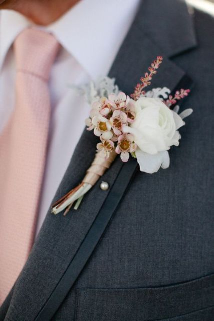 Pink shade groom boutonniere