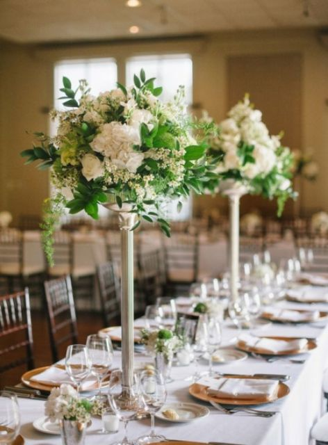 White color floral centerpiece in creative vases