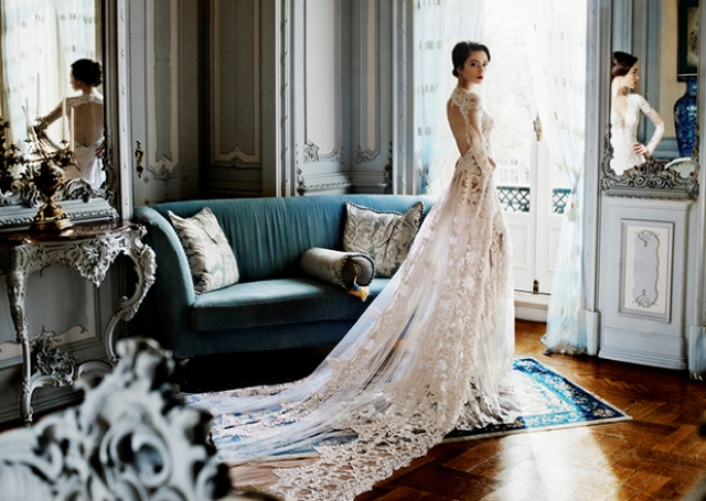 Sheer lace wedding dress with an opne back is perfect for romantic brides