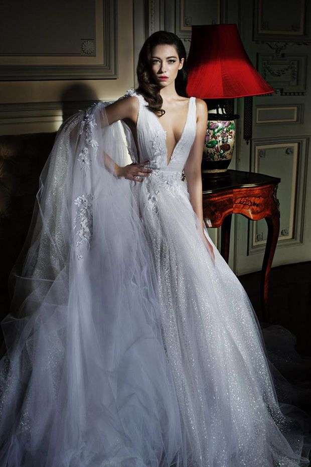 Glitter and flowers plunge neckline gown with a long train and a matching veil
