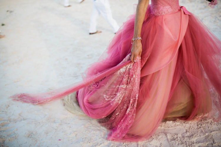 The bride chose a Vera Wang pink dress and customized it a bit