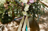 02 The florals are light and airy, the bouquet looks very relaxed and colorful ribbons make it even cooler