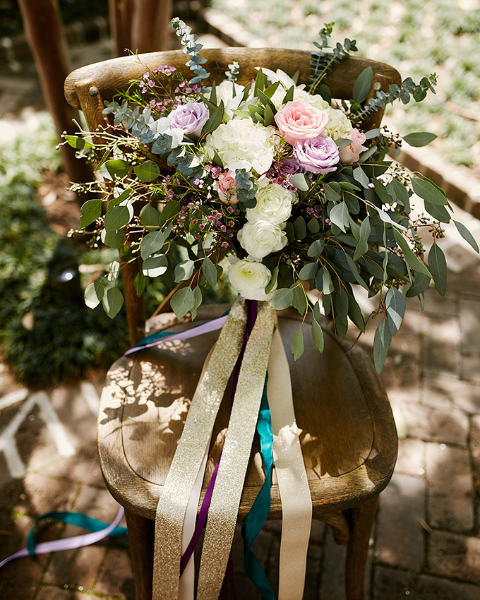 The florals are light and airy, the bouquet looks very relaxed and colorful ribbons make it even cooler