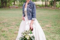 02 blue denim jacket with rolle dup sleeves over a modern wedding ball gown