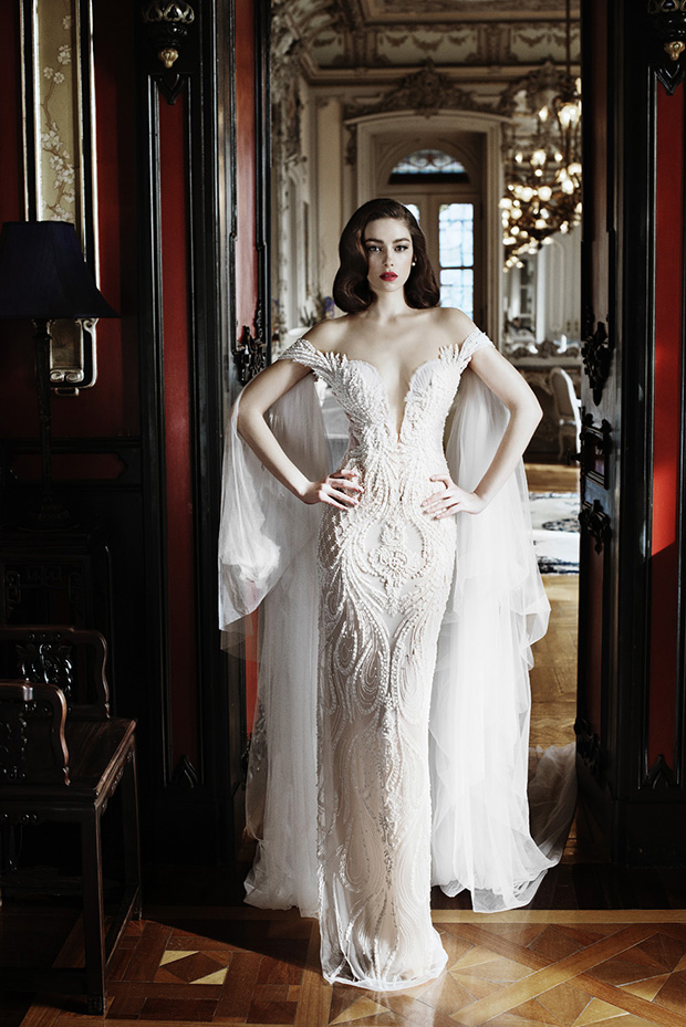 Incredible off the shoulder textural sheath dress with veil attached to the shoulders for fashion-forward brides