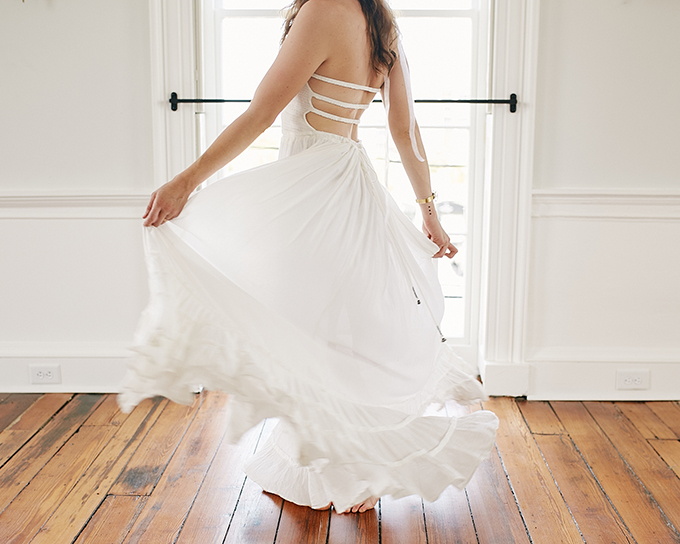 The wedding dress is a simple one with cutouts on the back