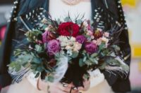 03 grunge bride in an ivory dress, a spiked leather jacket with bold makeup