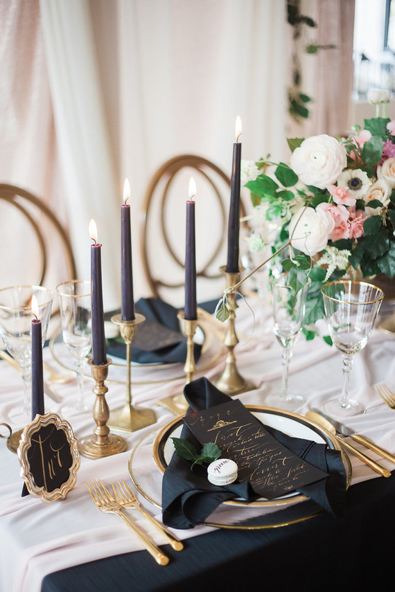 The gold tableware and gold edge plates look awesome with black napkins. Black and gold wedding details always looks great.