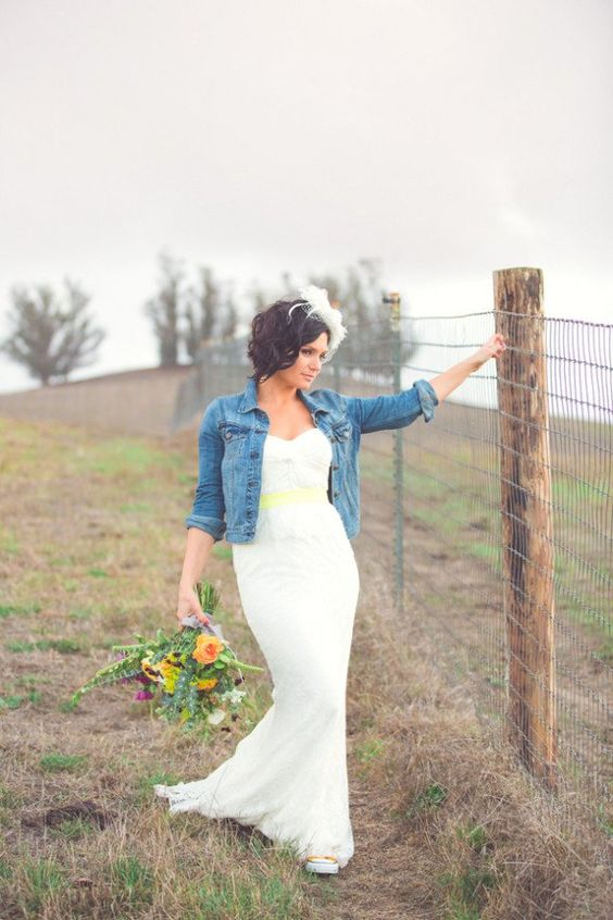 barn wedding look with a mermaid dress and a jean jacket
