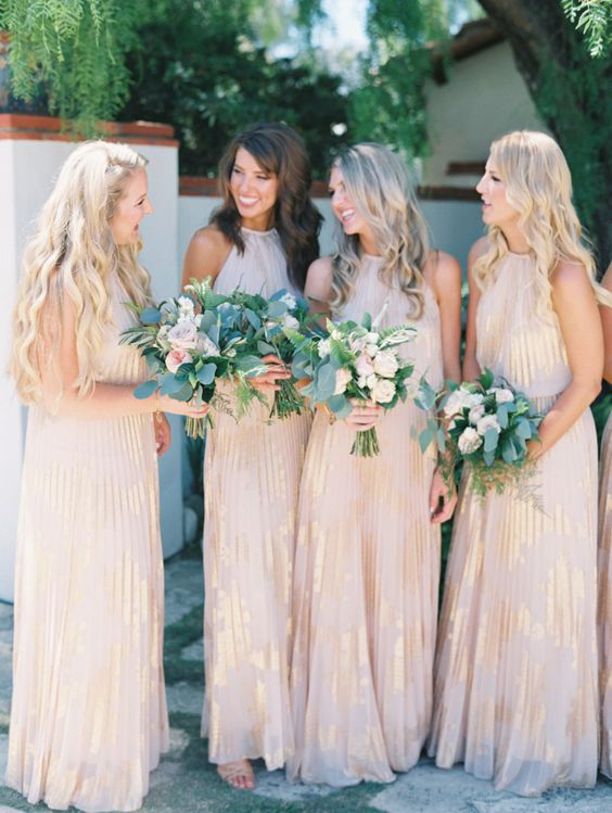blush and gold bridesmaids' gowns