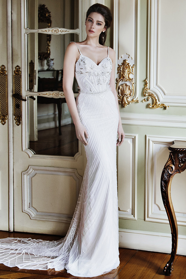 Spaghetti strap wedding dress with a sheer train and a glitter embroidery top