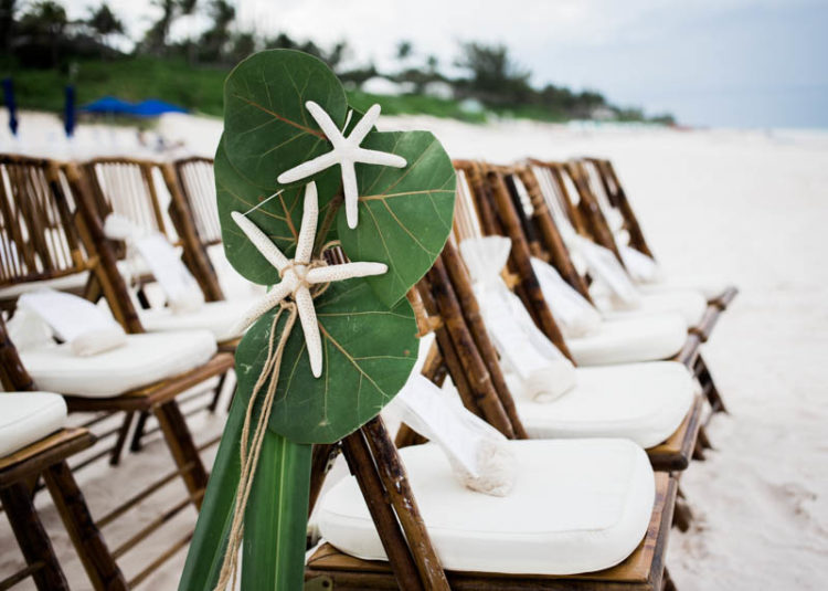 The wedding took place on the beach and decor was corresponding
