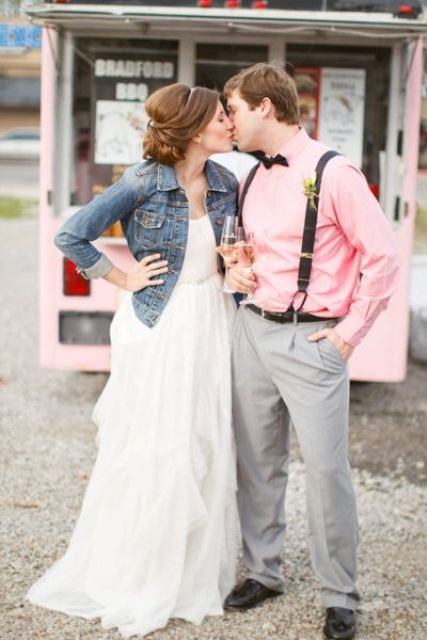 casual bride in a ruffle dress with a rhinestone sash and a denim jacket