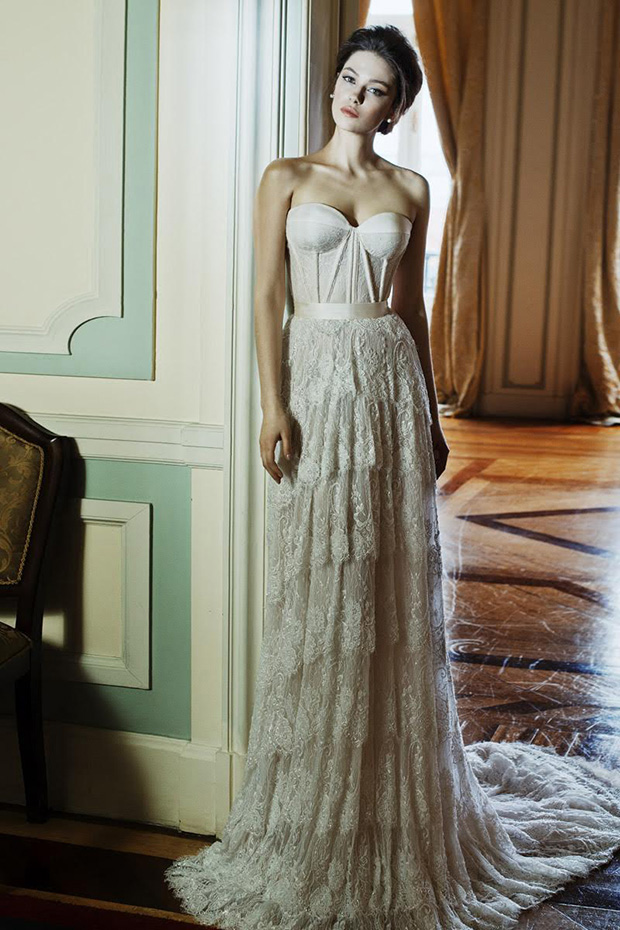 Modern take on a sweetheart wedding gown with a vintage lace skirt and a simple textural top