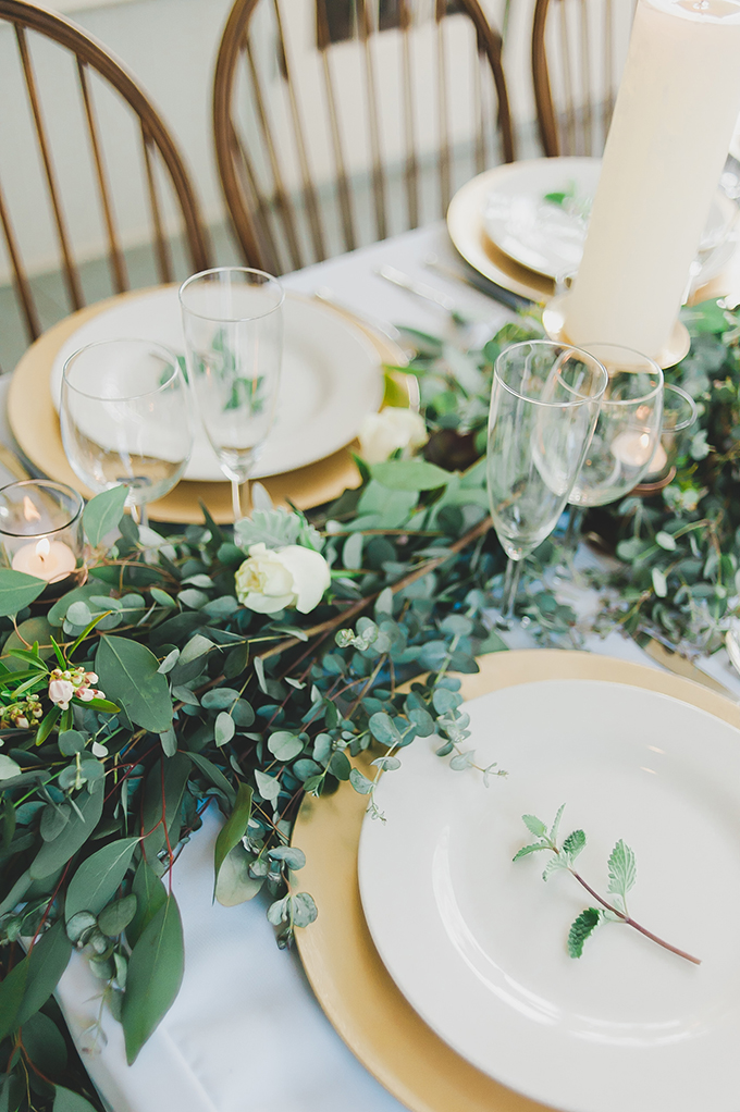 The tablescape was simple and natural with a greenery and white rose table runner
