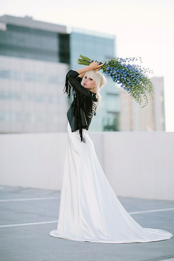 modern bridal dress with a fringed leather jacket