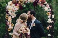 06 moody burgundy and blush floral arch for fall nuptials
