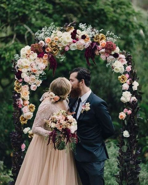 moody burgundy and blush floral arch for fall nuptials