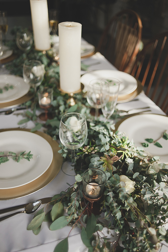 Gold chargers and glass candle holders made the table setting more refined