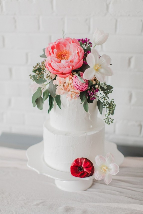 The cake was also boldly decorated with flowers of all kinds and sizes