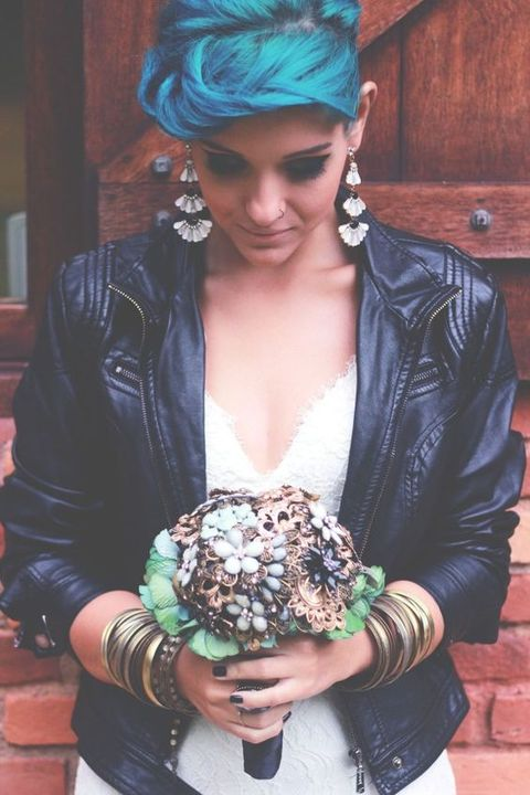 bride rocking blue hair and a brooch bouquet