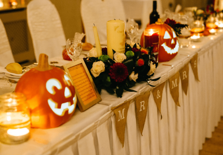 Jack-o-lanterns, burlap, candles and bold fall flowers created an ambience