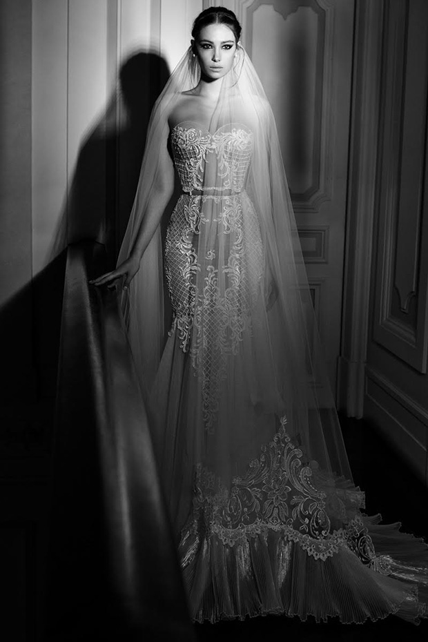 Nude and white sweetheart wedding gown with lace and a matching long veil