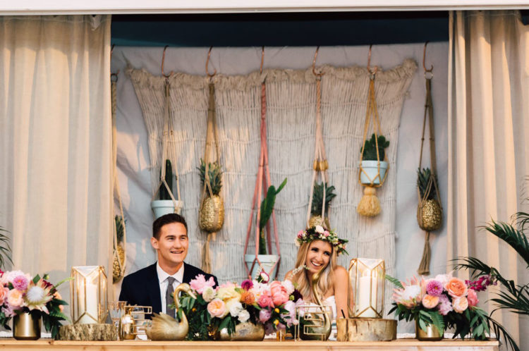 The reception was boho-chic, with lots of flowers and gilded pots