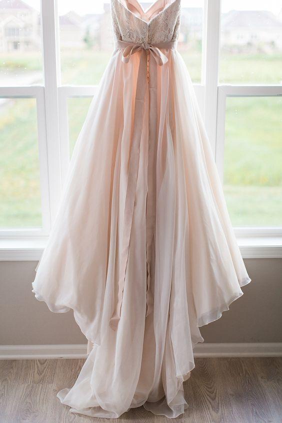 blush lace wedding dress with a train