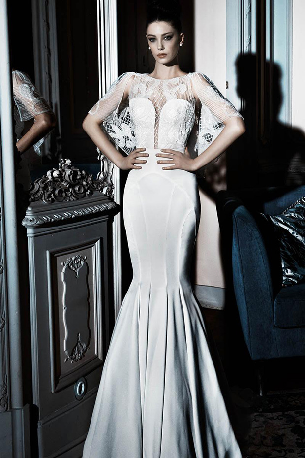 Plunging neckline mermaid wedding gown with a lace bolero