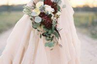 11 blush wedding gown and a marsala wedding bouquet