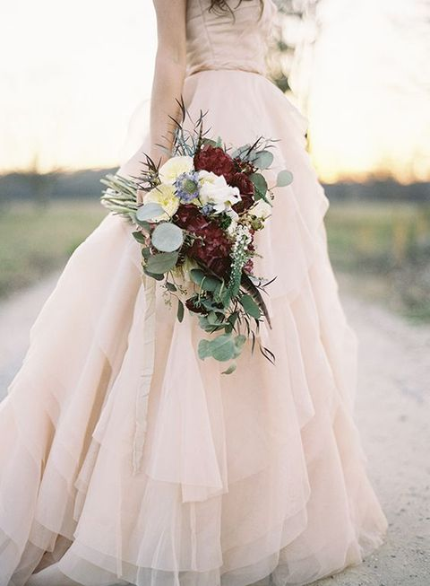 blush wedding gown and a marsala wedding bouquet