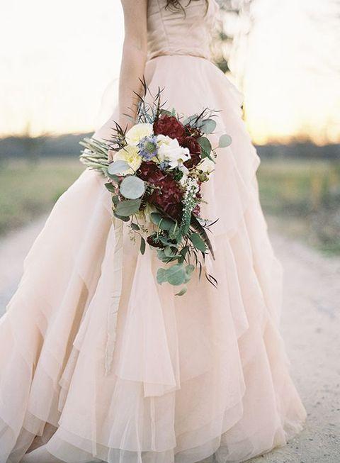 blush wedding gown and a marsala wedding bouquet