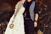 11 punk rock groom dressed in black with purple hair and red Converse