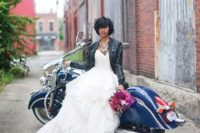 11 ruffled wedding dress with a black zip leather jacket and a statement necklace