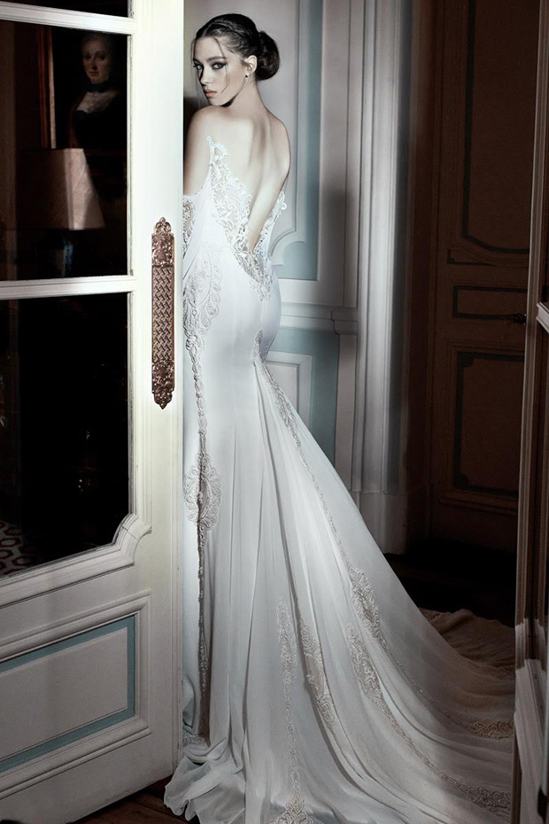 Luxe wedding dress with glitter and lace and a statement back