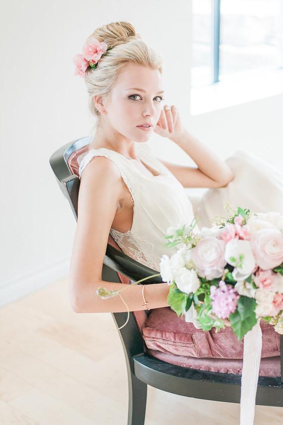 The bride rocked pink flowers in her hair