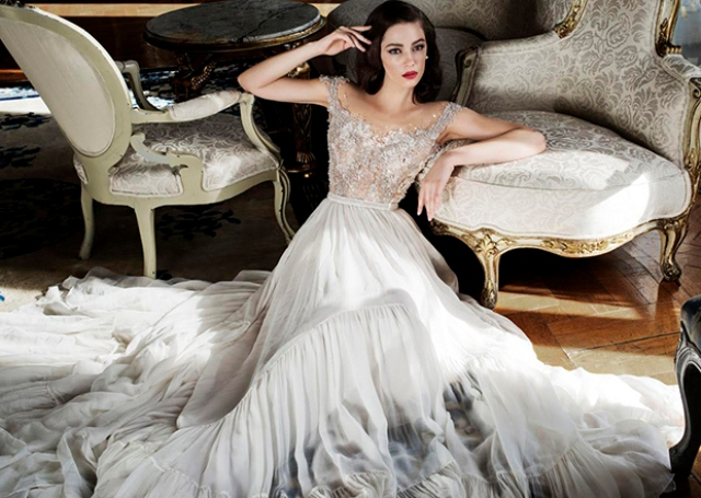 Wedding ball gown with a tulle skirt and a lace off the shoulder top